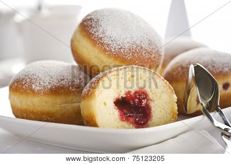 Jam filled Bismarck doughnuts closeup
