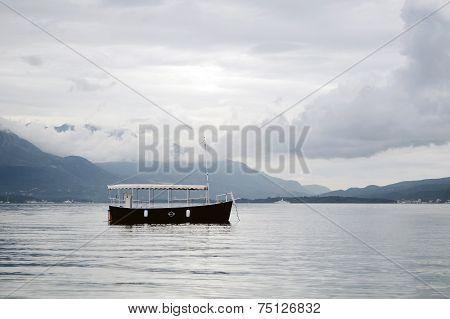 Early Morning. Lonely Boat In Boka Kotorska Bay, Montenegro