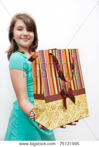 Shopping. Shopping teen girl excited and wondered. Dynamic image of teen girl with shopping bag