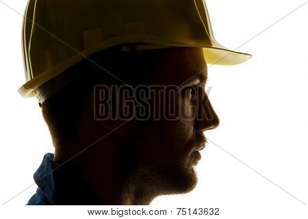a worker in a trade or business (craftsmen) with tool in hand