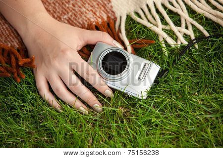 Photo Of Woman Holding Compact Camera On Grass