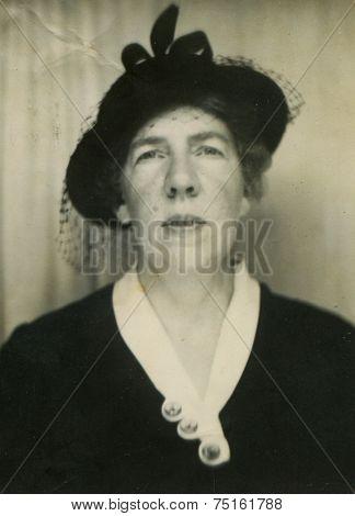 CANADA - CIRCA 1920s: Vintage photo shows studio portrait of a woman.