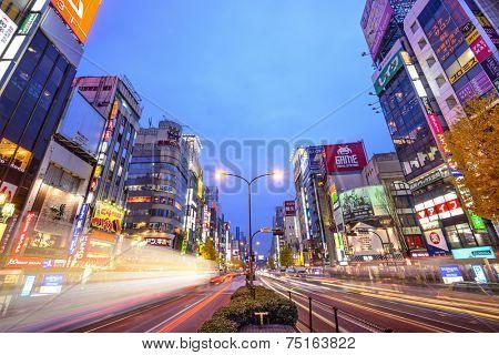 TOKYO, JAPAN - DECEMBER 15, 2012: Traffic passes through Shinjuku at Kabuki-cho. The area is a famed nightlife district.