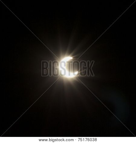 Photograph of solar eclipse taken midday in California. poster