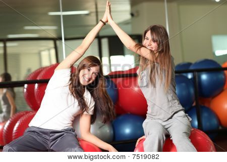 Two Happy Young Women In The Gym
