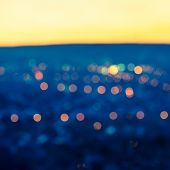 city blurring lights abstract circular bokeh blue background with twilight horizon closeup poster