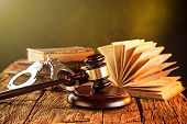 Wooden gavel and books on wooden table, law concept poster