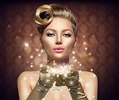 Holiday Retro Woman blowing magic dust in her hand. Beauty Fashion Christmas Vintage Style Lady with Beautiful Luxury Hairstyle, makeup, accessories. Golden Silk Gloves and dress  poster