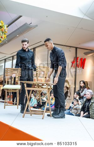 BADEN-BADEN, GERMANY - MARCH 7: Fashion model Fashion model demonstrates a new collection of garden furniture in a shopping center on March 7, 2015 in Baden-Baden. Germany. Europe.