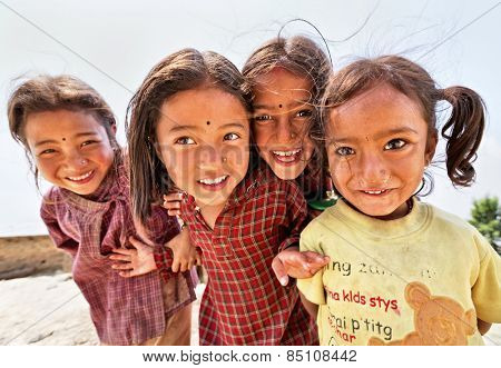 NAGARKOT, NEPAL - APRIL 5: Portrait of unidentified playful little Nepalese girls on April 5, 2009 in Nagarkot Village, Kathmandu, Central Region, Nepal.