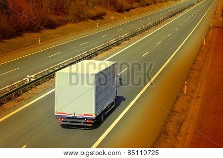 White truck on the highway. Retro style picture.