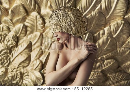 Fine art photo of a lady in gold