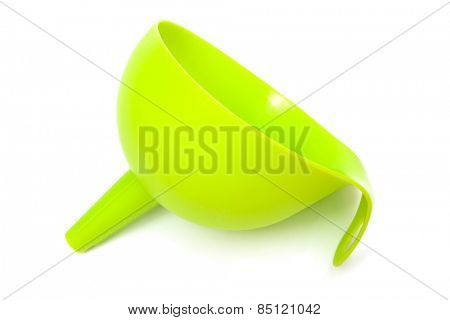 green plastic funnel with a white background
