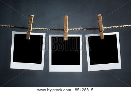 Blank instant print transfer photographs hanging on a clothesline