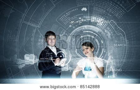 Young teacher and school boy at chemistry lesson