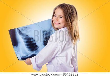 Little gilr playing doctor with x-ray