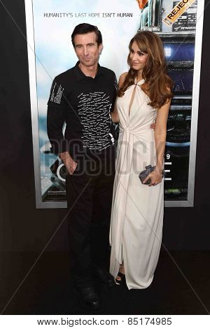 NEW YORK-MAR 4: Actors Sharlto Copley (L) and Tanit Phoenix attend the premiere of