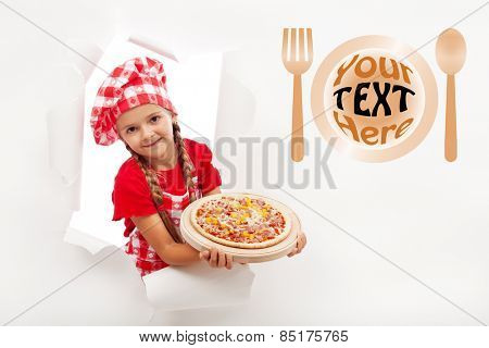 Little chef offering you a fresh pizza - leaning out from a hole in billboard, copyspace