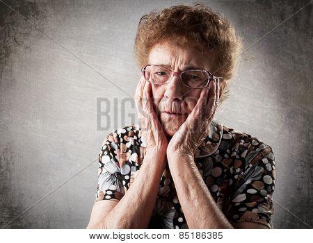 Portrait  old woman. Sad adult female. Grandmother