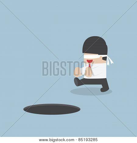 Blindfolded Businessman Walking Into The Hole