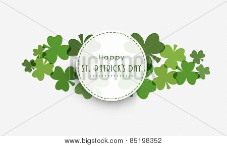 Happy St. Patrick's Day celebration sticker, tag or label design with shamrock leaves on grey background.