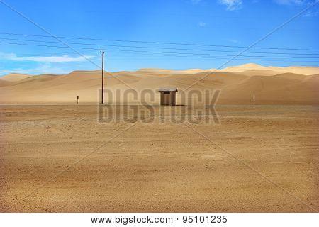Hut in Desert Sand Dunes