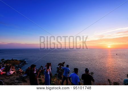 Large Group Of Tourist Waiting For The Sunset Over The Sea