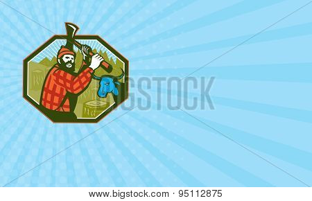 Business card showing illustration of Paul Bunyan a lumberjack sawyer forest worker swinging an axe with tree stumps and Babe the blue ox bull cow in background set inside hexagon done in retro style poster