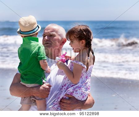 grandfather holding his grandkids