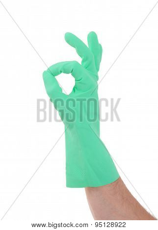 Hand Gesturing With Green Cleaning Product Glove