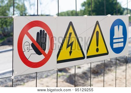 Warning Signs On Fence At Construction Site
