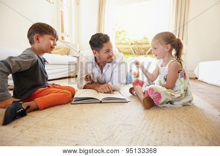 Father With His Little Boy And Girl At Home
