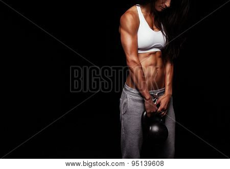 Female Doing Body Building Exercise With Kettle Bell