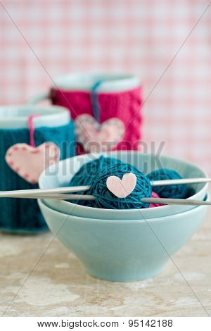 Bright Balls Of Yarn In Blue Plates And Handmade From Felt Heart