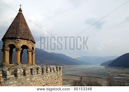 Georgia, Zhinvali-March,1 2015:View on winter shallowed Zhinvali reservoir from Ananuri Castle. Georgia poster