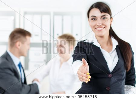 Beautiful Smiling Business Woman In Suit Offering Hand To Shake