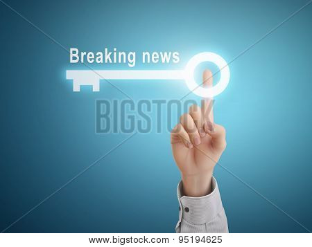Male Hand Pressing Breaking News Key Button
