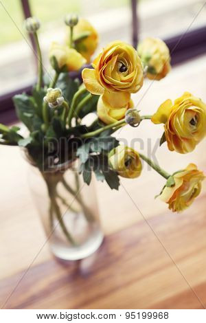 Overhead Angled View Of Vase Of Yellow Flowers