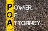 Concept image of Business Acronym POA as Power Of Attorney written over road marking yellow painted line. poster