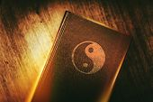 Taoism Book of Harmony. Taoism Also Called Daoism is a Philosophical Ethical or Religious Tradition of Chinese Origin. Taoism Symbol on the Book Cover. poster