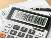 calculator with the word interest rate on the display poster