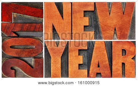 2017 New Year greeting card  - isolated word abstract  in letterpress wood type printing blocks stained by red ink