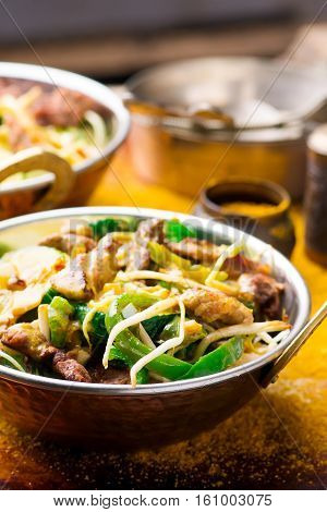 Indian-Style Pork Saute in copper bowl .selective focus
