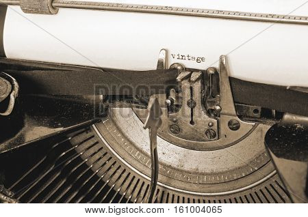 Close up of old typewriter and vintage text on paper sepia style