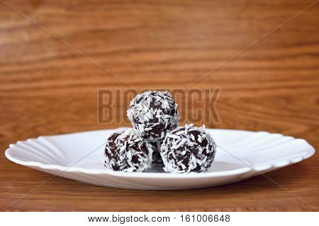 Christmas Sweets On A Plate - Rum Balls In Coconut. Traditional Homemade Handmade Czech Sweets.