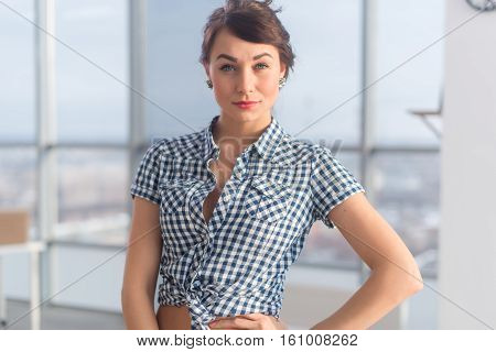 Confident positive young woman posing, smiling. Gorgeous friendly looking brunette girl, standing sideways