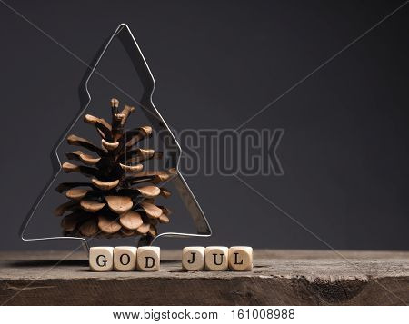 God Jul on wooden dices Scandinavian words of Merry Christmas