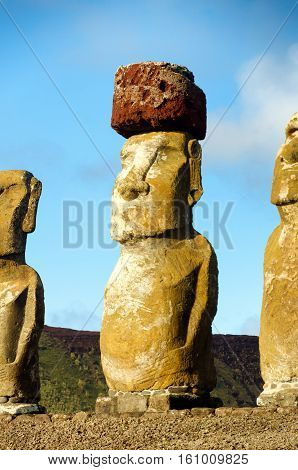 Moai closeup on Easter Island Chile. The red stone on its head is called a pukao
