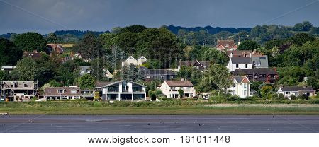 Houses on the Exe river. Low tide. Devon. England