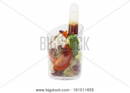 Mini desserts and meat canapes vegetable snacks in plastic cups canaps